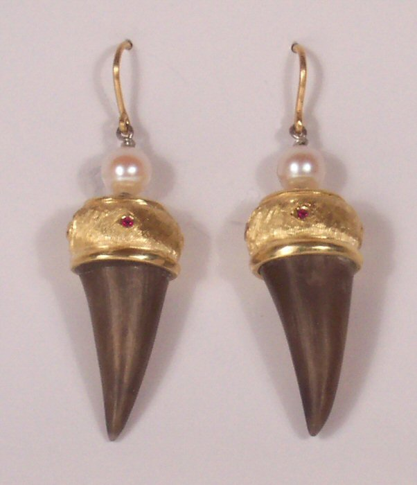 At Left Thoroughly Unique Earrings Turkey Spurs Have Been Custom Fit Into Hand Carved 18k Yellow Gold Caps That Small Rubies Ed Around Them